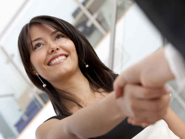 Business woman handshaking with an other person